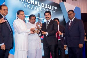 Director/CEO of ABM Mr.M.Ramachandran receives the award from President Maithreepala Sirisena.